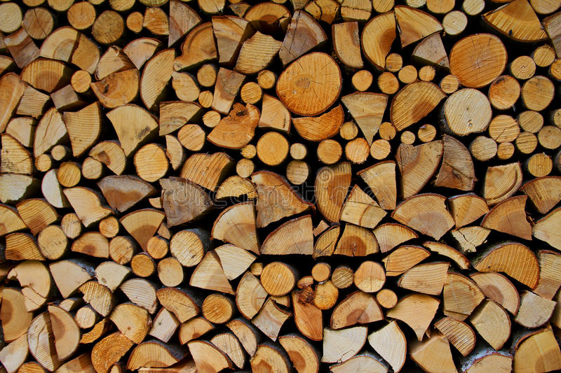 Chopped fire wood background texture stock images