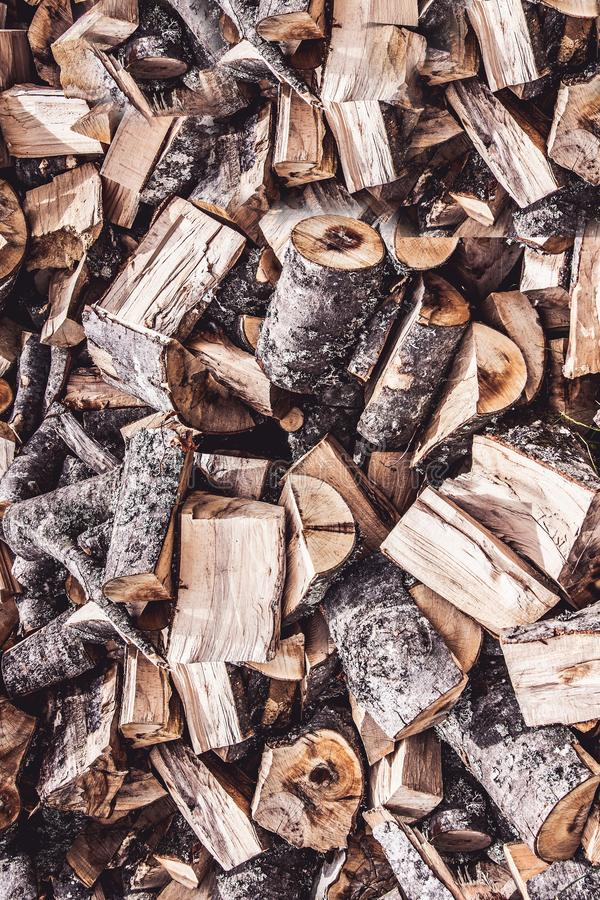 Chopped Fire Wood Logs Stack Pile Background. Chopped Fire Wood Logs Stack Pile Abstract Background royalty free stock photo