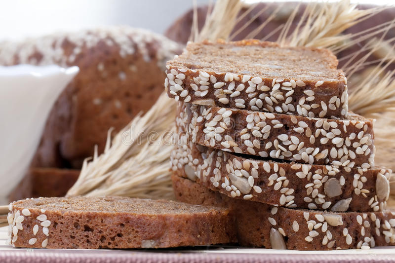 Chopped fresh rye bread. Sprinkled with sesame seeds stock photo