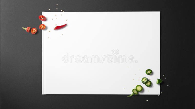 Chopped green chilies and chopped red chilies on white paper stock photo