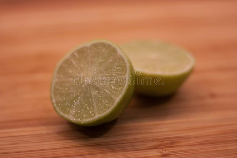 Chopped lime. On chopping board royalty free stock image
