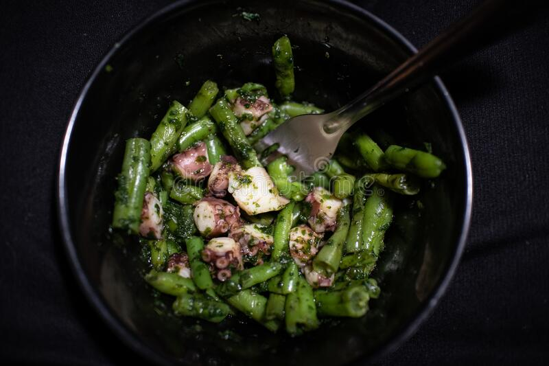 Chopped Octopus and Green Beans with Spinach stock photography