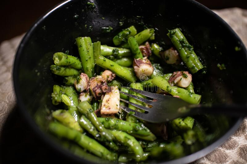 Chopped Octopus and Green Beans with Spinach royalty free stock image