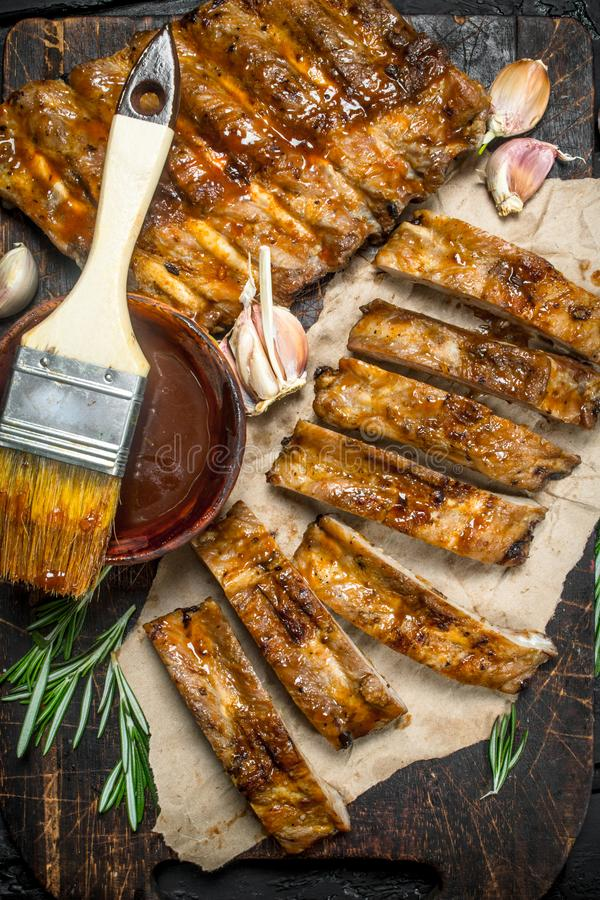 Chopped ribs grilled with a sauce royalty free stock photos