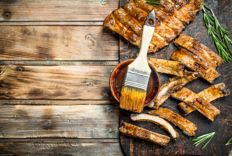 Chopped ribs grilled with a sauce stock images