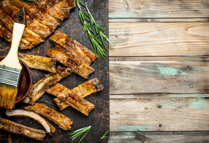 Chopped ribs grilled with a sauce stock image