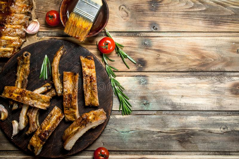 Chopped ribs grilled with a sauce stock photography
