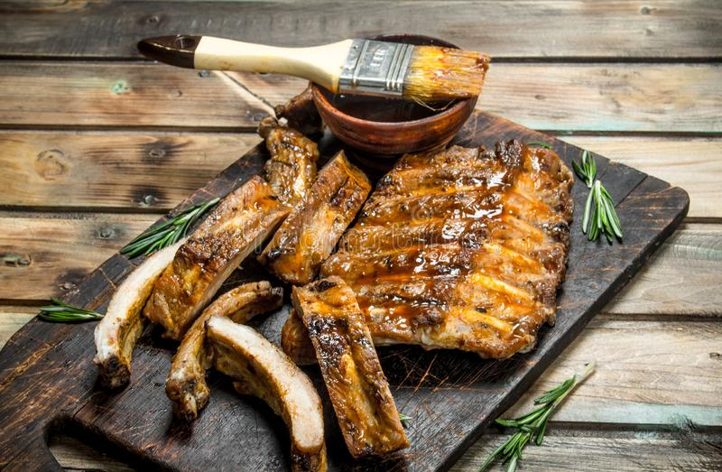 Chopped ribs grilled with a sauce stock photos