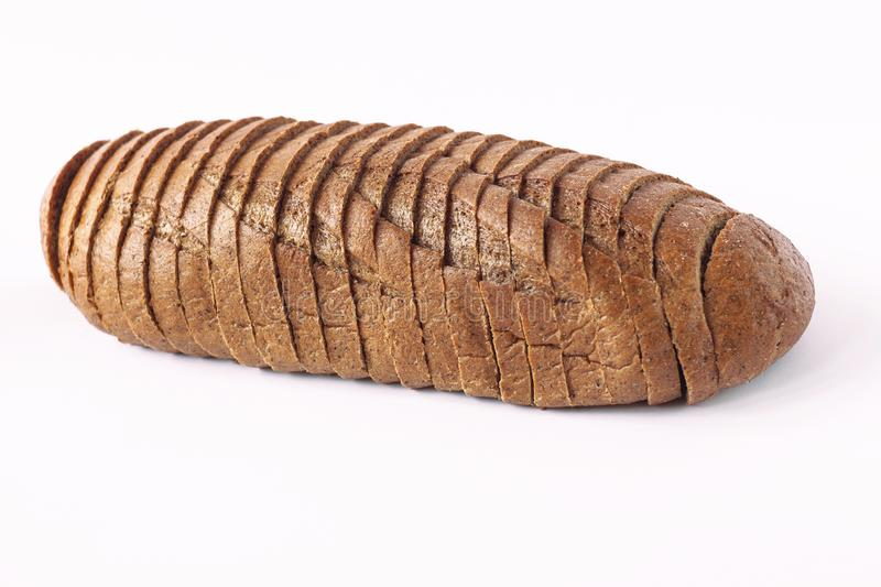 Chopped Rye bread on a white background isolated. Rye bread on a white background isolated. Chopped bakery products made with various percentages of flour from stock images