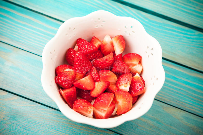 Chopped strawberries stock photography