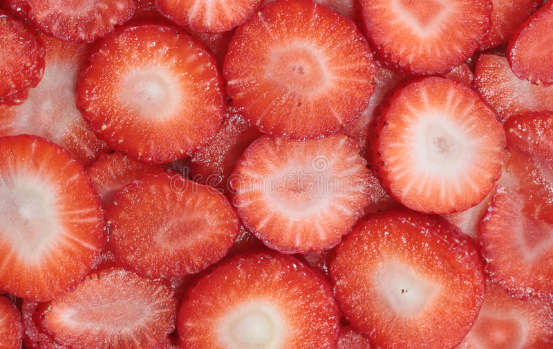 Chopped strawberries. Red strawberries chopped into rings royalty free stock photography