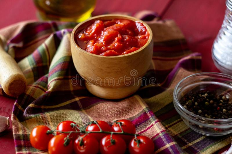 Chopped tomatoes on a red background. Vegetarian food royalty free stock photography