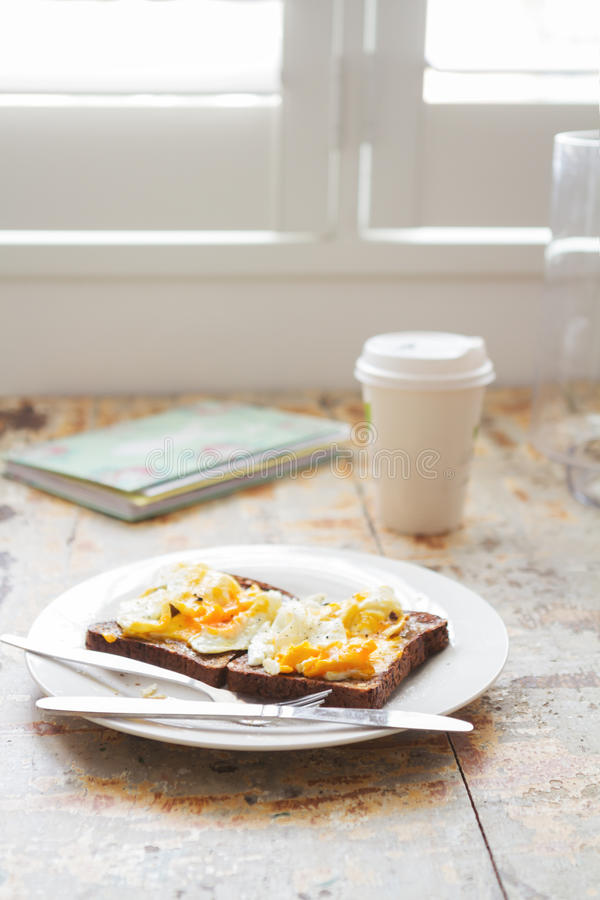 Chopped up poached eggs on dark rye healthy breakfast royalty free stock photos