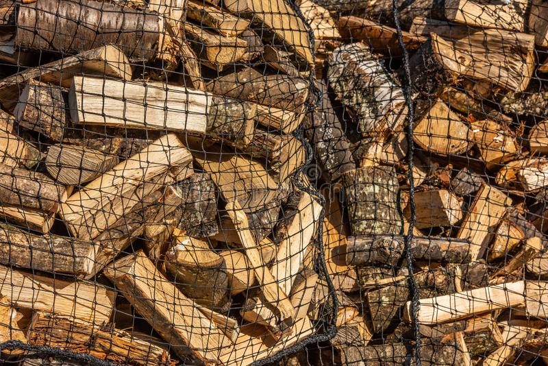 Chopped wood loaded into nets royalty free stock photos