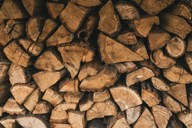 Chopped wood in the stack. Wooden firewood logs superimposed on each other. royalty free stock image