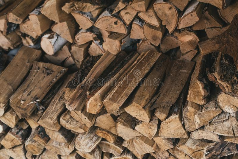 Chopped wood in the stack. Wooden firewood logs superimposed on each other. stock images