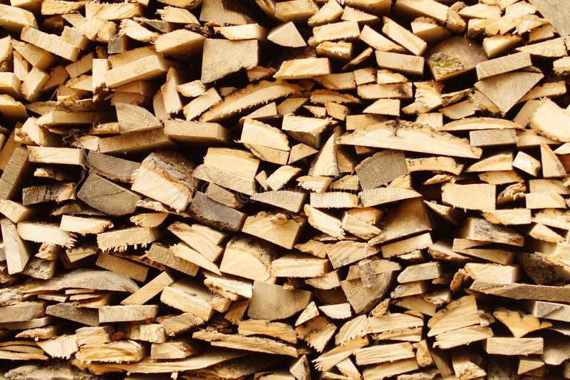 Chopped wood, stacked in a woodpile stock photography