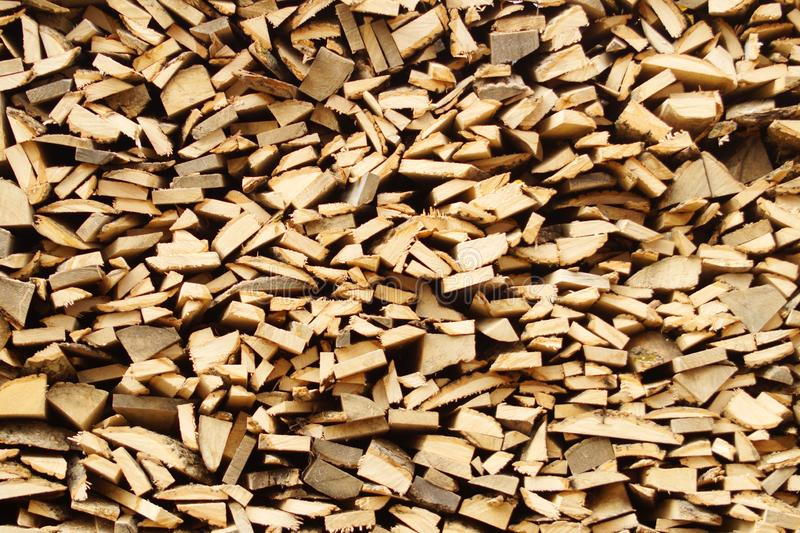 Chopped wood, stacked in a woodpile stock image