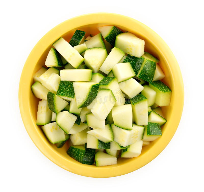 Chopped zucchini in a bowl isolated on white stock image