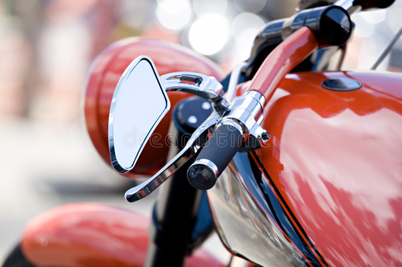 Chopper. Motorcycle chopper closeup - shallow depth of field with focus on end of handlebars royalty free stock photo