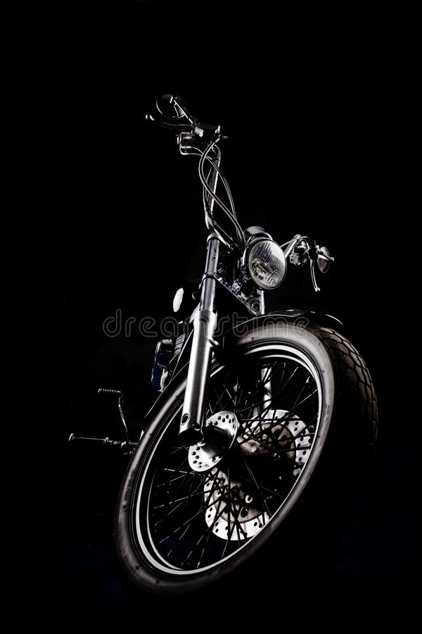 Chopper in a dark. Chopper motorcycle front isolated on black royalty free stock photos
