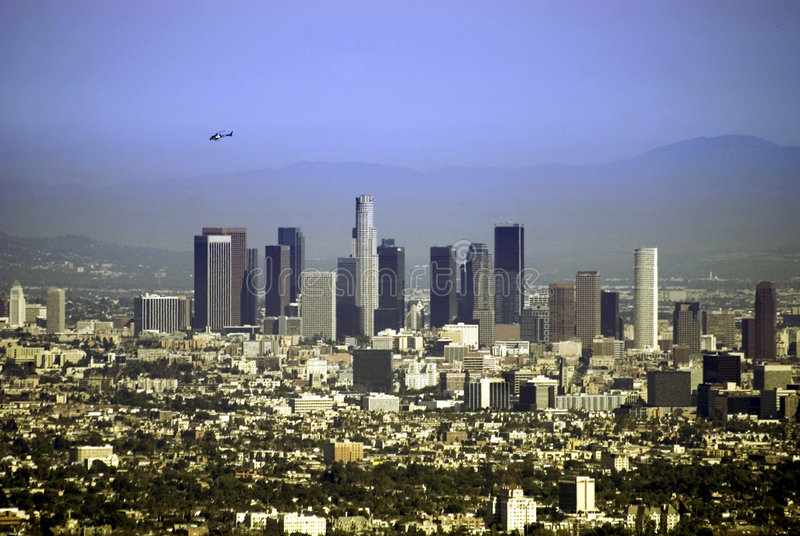 Chopper of Los Angeles. Helicopter flying over downtown Los Angeles skyscrapers stock photo