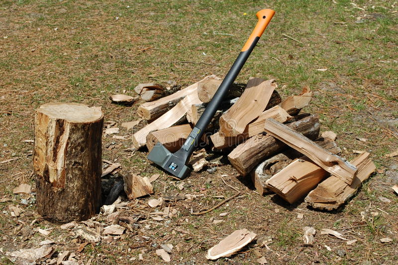 Chopping block ax and split wood stock image of
