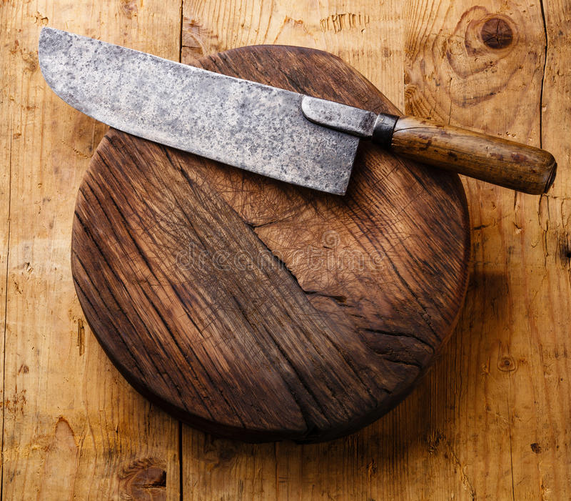 Chopping block and Meat cleaver. Chopping board block and Meat cleaver large chef's knife on wooden background royalty free stock image