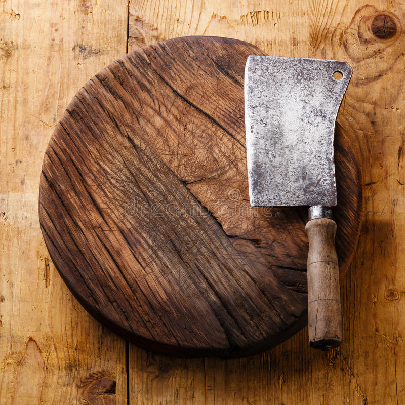Chopping board block and Meat cleaver. Large chef's knife on wooden background royalty free stock photo