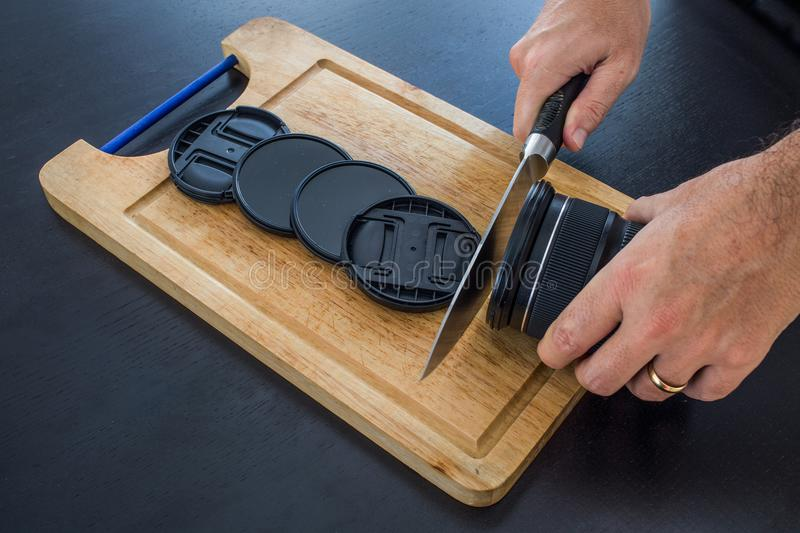 Chopping board with hand wich looks like cutting camera lens creating filters and closing cups. royalty free stock photo