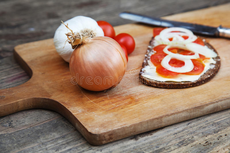 Download Chopping Board With Tomato Bread Royalty Free Stock Image - Image: 30601876