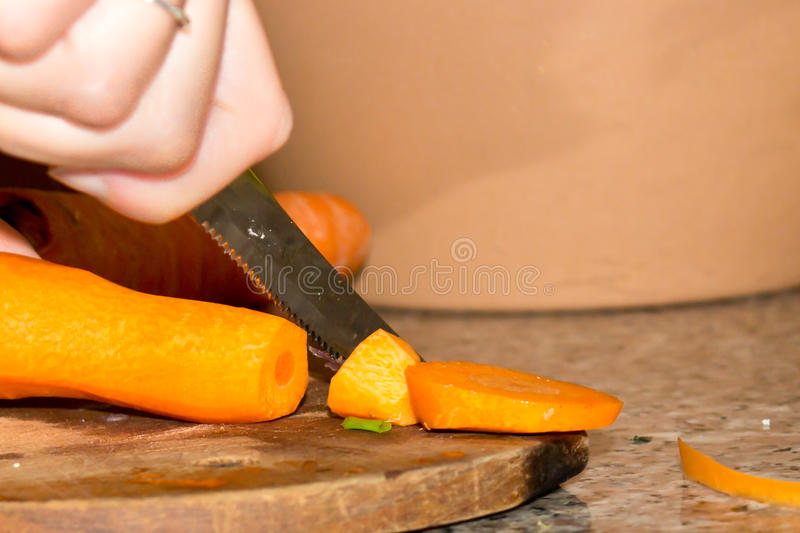 Chopping carrot. For the salad stock photo