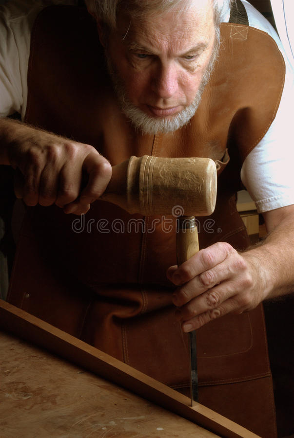 Chopping a mortise stock images