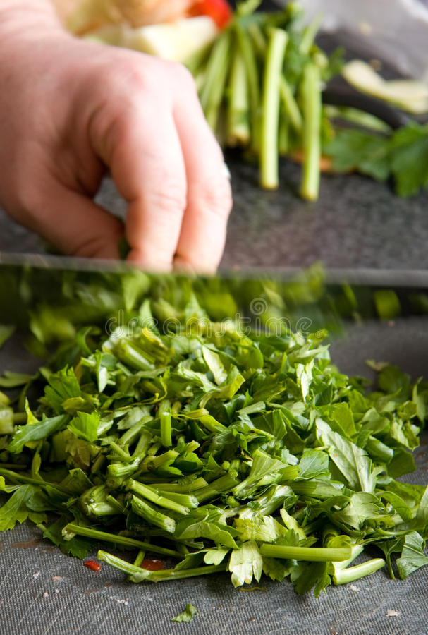 Chopping parsley royalty free stock image