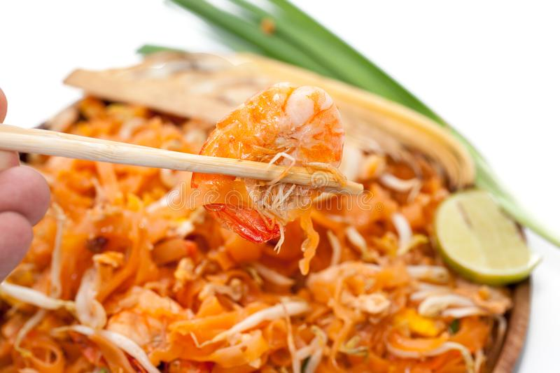 Chopstick and pad thai noodle. On plate royalty free stock images