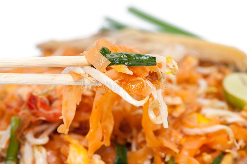 Chopstick and pad thai noodle. On plate royalty free stock photos