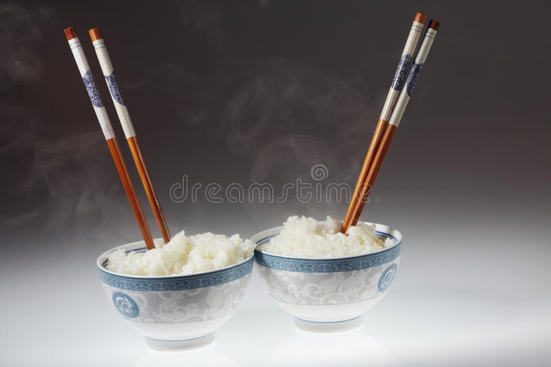 Chopstick and rice. Chopstick and white bowl with rice stock photography