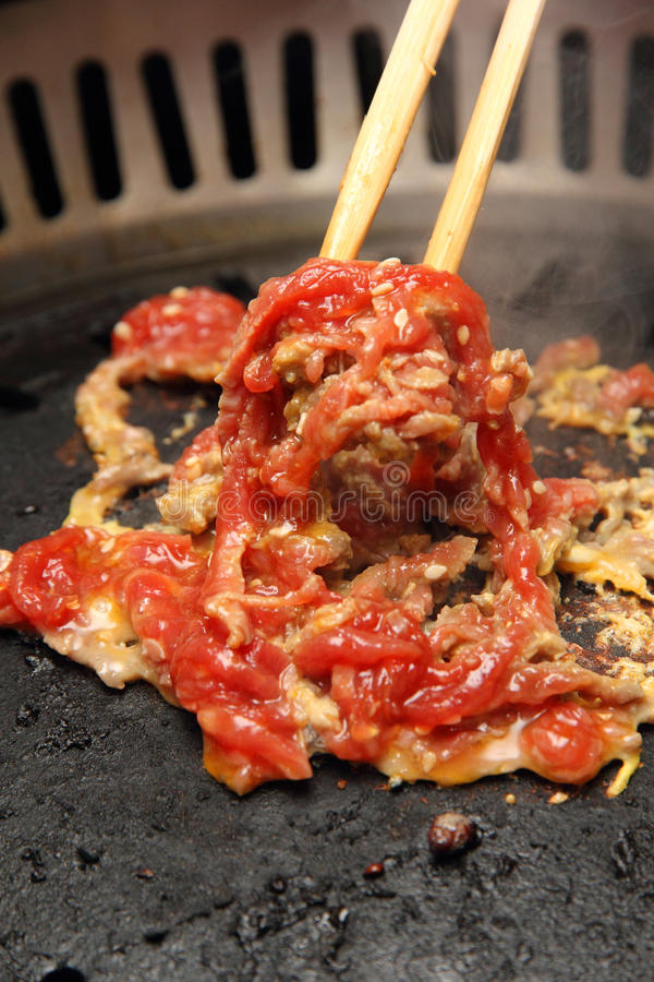 Chopstick stirring a mix of meat and egg royalty free stock photography