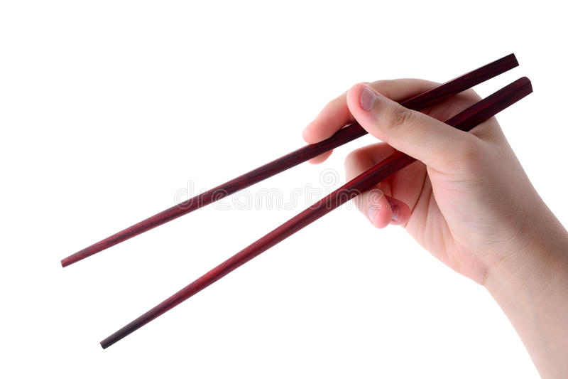 Chopsticks da terra arrendada da mão fotografia de stock royalty free