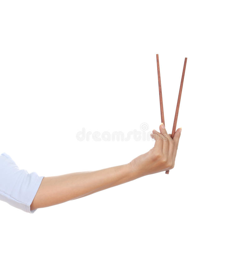 Chopsticks in a hand stock photography