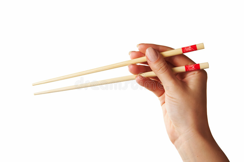 Chopsticks in hand royalty free stock images