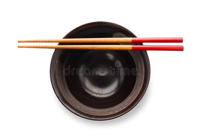 Chopsticks i czerń puchar zdjęcie stock