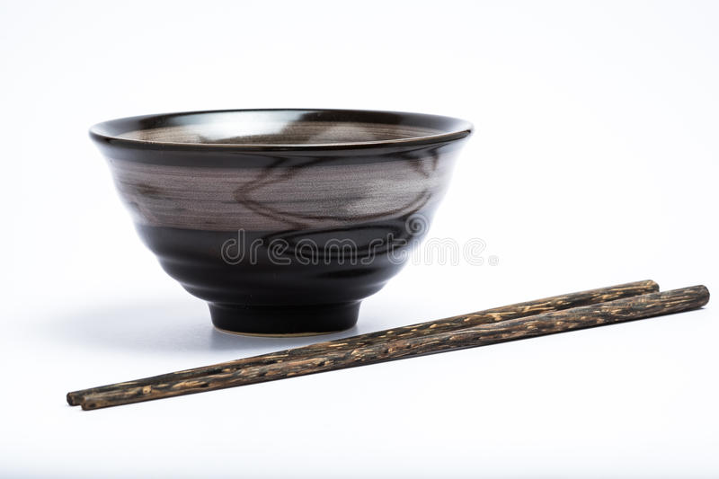Chopsticks and japanese style bowl royalty free stock image