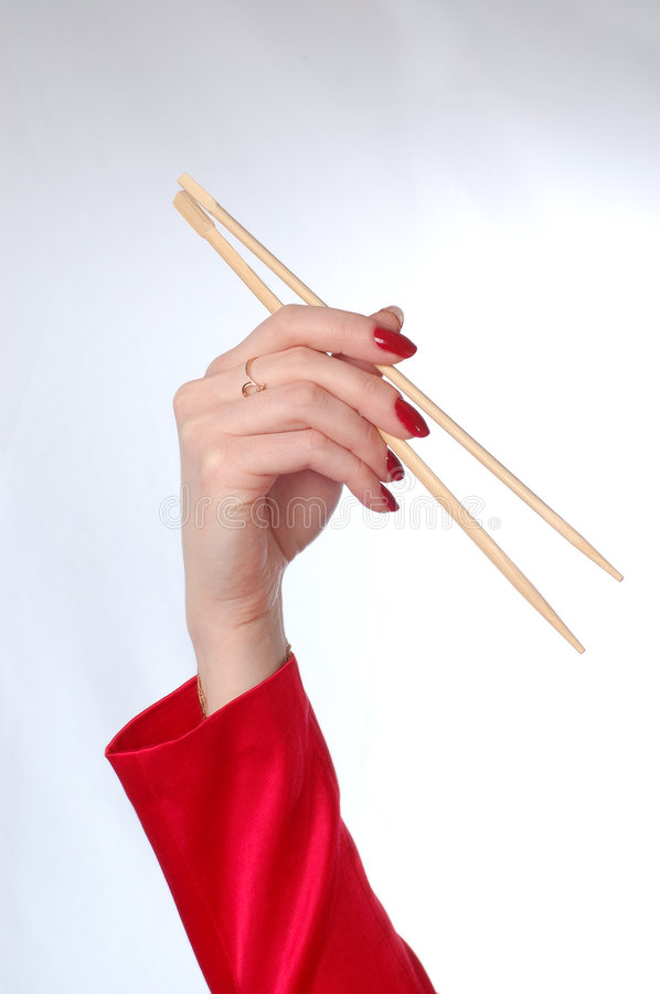 Chopsticks na ręce obraz stock