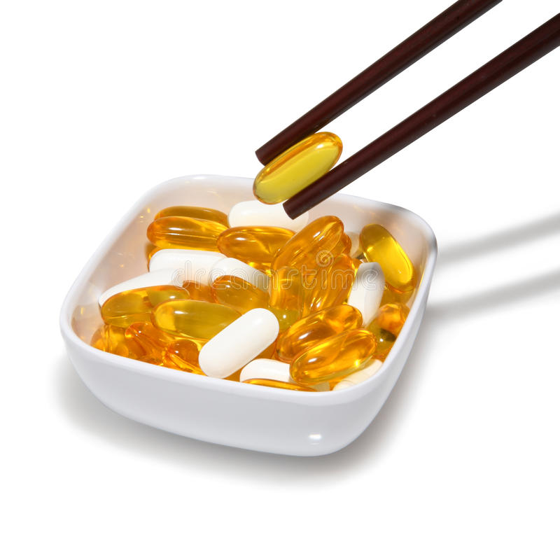 Chopsticks And Pills Royalty Free Stock Image
