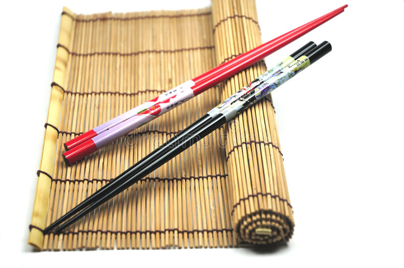 Download Chopsticks on placemat stock photo. Image of bamboo, still - 12684846