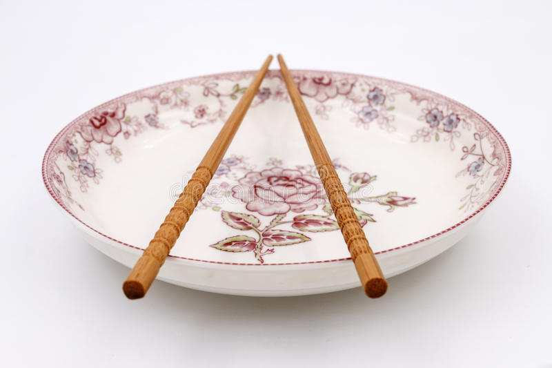 chopsticks on plate stock photo