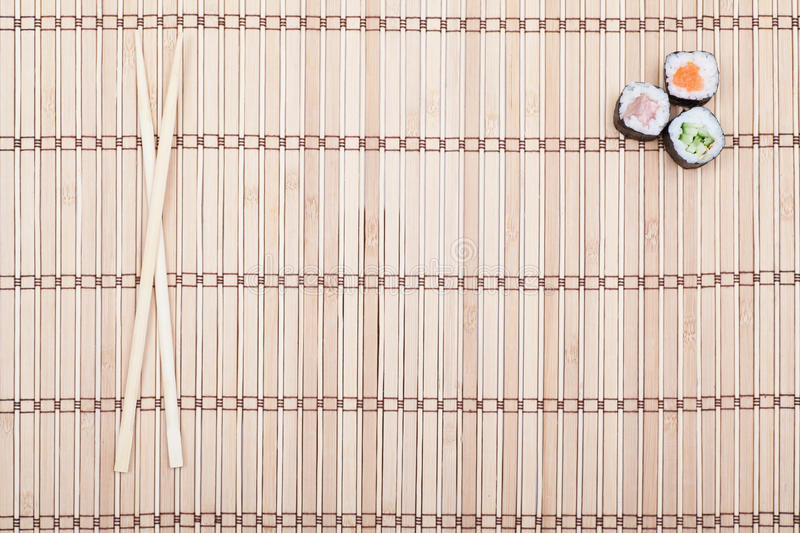 Download Chopsticks And Sushi Roll On Bamboo Mat Stock Photo - Image: 27161470