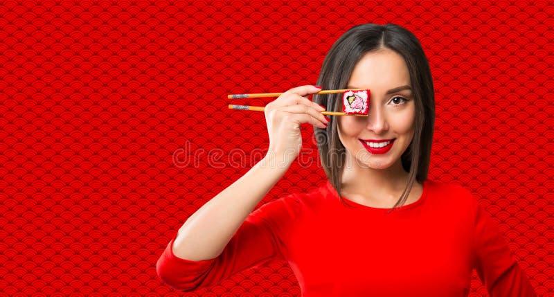 chopsticks target2488_1_ suszi kobiety młody zdjęcie stock