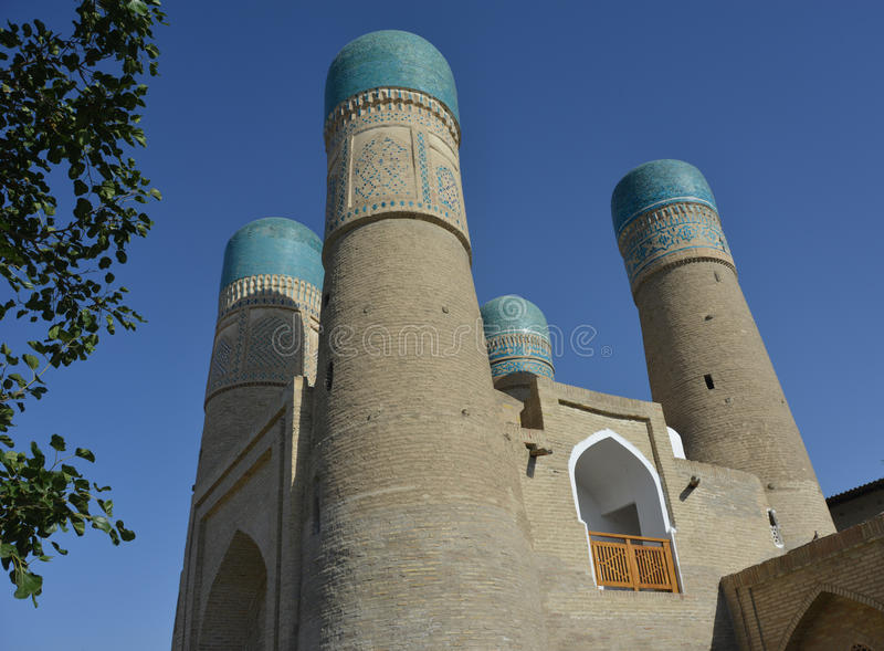 Chor-Minor - Bukhara. This is an entrance to medrese Chor-Minor in Bukhara (Uzbekistan). The building is situated against the blue sky background stock photography